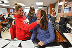 Susie Dinees  has her hearing checked by lab partner Abby Johnson. Photo by Robert Jordan/Ole Miss Communications