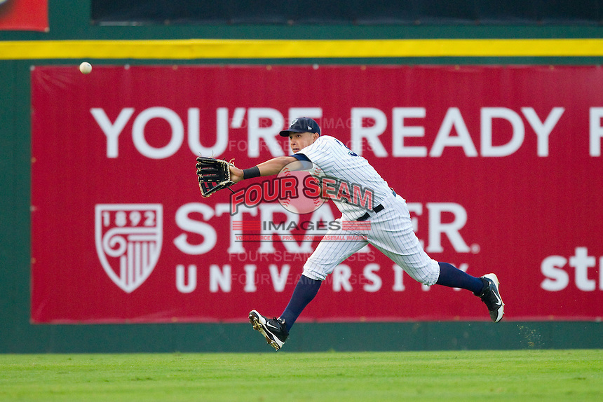 Charlotte Knights center fielder Avisail Garcia (36) makes a running catch against the Lehigh Valley IronPigs at Knights Stadium on August 6, 2013 in Fort Mill, South Carolina.  The IronPigs defeated the Knights 4-1.  (Brian Westerholt/Four Seam Images)
