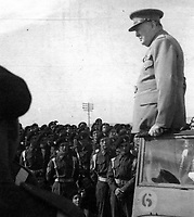 BNPS.co.uk (01202 558833)<br /> Pic: Pen&Sword/BNPS<br /> <br /> Churchill addressing the troops of the 4th Hussars, 3 December 1943<br /> <br /> Previously unseen photos of Winston Churchill both in the theatre of war and at leisure afterwards have come to light in a new book.<br /> <br /> One snap shows him addressing troops of his 4th Hussars regiment in Cairo, while he is seen in another at the door of an aircraft with a trademark cigar in his mouth. <br /> <br /> There is also a candid image of the wartime leader painting at Lake Como in September 1945 where he convalesced after losing to Clement Attlee in the general election.<br /> <br /> The photos belonged to Lieutenant Colonel Anthony Barne, who was commanding officer of the 4th Hussars.<br /> <br /> The photos, and Lt Col Barne's war diaries, are published for the first time in a new book, Churchill's Colonel, which has been edited by his grandson Charles Barne.