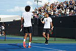Bar Botzer (right) of the Wake Forest Demon Deacons celebrates with doubles partner Skander Mansouri after their win at #1 doubles clinched a point against the Ohio State Buckeyes during the 2018 NCAA Men's Tennis Championship at the Wake Forest Tennis Center on May 22, 2018 in Winston-Salem, North Carolina. (Brian Westerholt/Sports On Film)