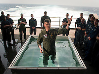 110508-N-DR144-075 ARABIAN SEA (May 8, 2011) Chaplain Lt. Jeffrey Ross addresses a congregation of Sailors after a baptism service on the fantail of Nimitz-class aircraft carrier USS Carl Vinson (CVN 70). Carl Vinson and Carrier Air Wing (CVW) 17 are underway in the U.S. 7th Fleet area of responsibility. (U.S. Navy photo by Mass Communication Specialist 2nd Class James R. Evans / Released)
