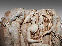 Close up of a Roman Sebasteion relief sculpture, Aphrodisias of Dionysus as a baby, Aphrodisias Museum, Aphrodisias, Turkey.  <br /> <br /> Baby Dionysus is handed from one nymph to another for suckling. A bearded Silenos gestures excitedly. The scene is set at Nysa in the Meander Valley, where Zeus had his gifted child Dionysos, born to him by Semele and brought up in the wilds out of the view of Hera.