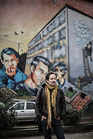 Miguel Tapia, former percussionist of the Chilean rock band Los Prisioneros, stands in front of a giant graffity of his former band in Santiago, Chile, October 2012...Photo by Roberto Candia