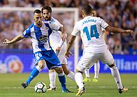 Deportivo de la Coruna's Guilherme Dos Santos (l) and Real Madrid's Isco Alarcon (c) and Carlos Henrique Casemiro during La Liga match. August 20,2017.  *** Local Caption *** © pixathlon