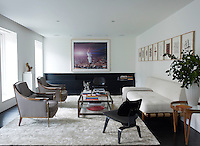 The first-floor living room is furnished with a Robsjohn-Gibbings sofa, a pair of Andre Arbus armchairs