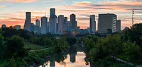 This is a pano of the Houston skyline at sunrise over the Buffalo Bayou in downtown area. Right before the sun rise came up we had some nice oranges, pinks, red colors that popped out from behind the city skyline and these color also reflected on the water of the Buffalo bayou along with many of the city high rise skyscrapers being reflected in the bayou also.  Houston is a city of many skyscrapers and these are some of the taller one in the city from the park pedestrian bridge over the bayou.