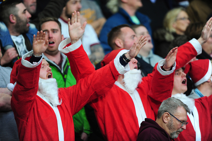 Burnley fans dressed up as Father Christmas during the first half<br /> <br /> Photographer Chris Vaughan/CameraSport<br /> <br /> Football - The Football League Sky Bet Championship - Hull City v Burnley - Saturday 26th December 2015 - Kingston Communications Stadium - Hull<br /> <br /> &copy; CameraSport - 43 Linden Ave. Countesthorpe. Leicester. England. LE8 5PG - Tel: +44 (0) 116 277 4147 - admin@camerasport.com - www.camerasport.com