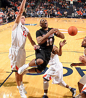 Dec. 22, 2010; Charlottesville, VA, USA; Seattle Redhawks guard Sterling Carter (10) is fouled by Virginia Cavaliers guard Joe Harris (12) during the game at the John Paul Jones Arena. Seattle Redhawks won 59-53. Mandatory Credit: Andrew Shurtleff-