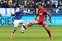 (L-R) Ross Wallace of Sheffield Wednesday and Kyle Naughton of Swansea City in action during The Emirates FA Cup Fifth Round match between Sheffield Wednesday and Swansea City at Hillsborough, Sheffield, England, UK. Saturday 17 February 2018