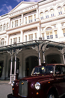 Famous Raffles Hotel Luxury Resort with elegant Taxi in front One of the worlds great hotel