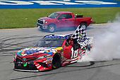 #18: Kyle Busch, Joe Gibbs Racing, Toyota Camry Skittles Red White & Blue celebrates after winning