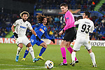 Getafe CF's Marc Cucurella (2l), FC Krasnodar's Tonny Vilhena (l) and Magomed Suleymanov (r) and German referee Daniel Siebert during UEFA Europa League match. December 12,2019. (ALTERPHOTOS/Acero)