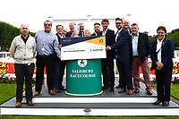 Connections of Move Over receive their cheque from Sponsors after winning The M J Church British EBF Novice Stakes (Plus 10) (Div 1), during Afternoon Racing at Salisbury Racecourse on 7th August 2017