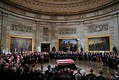 The flag-draped casket of former President George H.W. Bush lays inside the Rotunda of the Capitol in Washington, Monday, Dec. 3, 2018. (AP Photo/Pablo Martinez Monsivais/Pool)
