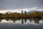 Idaho, Northern, Kingston. Reflections in the Coeur d Alene River at Old Mission State Park at dawn in autumn.