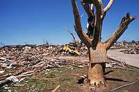 """God was Here"" sign on tree in a destroyed neighborhood in Moore Oklahoma after the passage of an F-5 tornado on May 3rd, 1999."