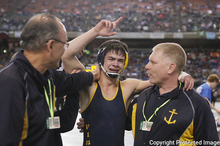 ILWACO''s Rkik Thompson celebrates his 4-2 win over REARDAN's Colton Kuykendall after their 138 pound matchwith Gene Ford , left, and Kevin McNulty, right,on Saturday, February 19, 2016 at the Mat Classic XXVIII Championship matches held in the Tacoma Dome.   Thompson took the gold medal with a 4-2 victory.(Jim Bryant Photo)