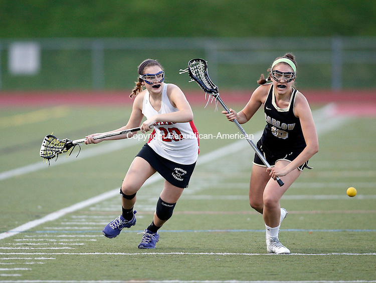 Southbury, CT- 07 May 2015-050715CM09-  Pomperaug's Kayla Kasmire, left, carries the ball as Joel Barlow's Gabby Saluzzi defends during their SWC lacrosse matchup in Southbury on Thursday.   Christopher Massa Republican-American