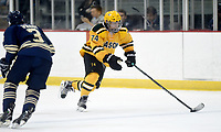George Mason's Cameron Smith (74) skates past a George Washington defender into the offensive zone. George Mason defeated George Washington 5-2 on 9-22-18.<br />