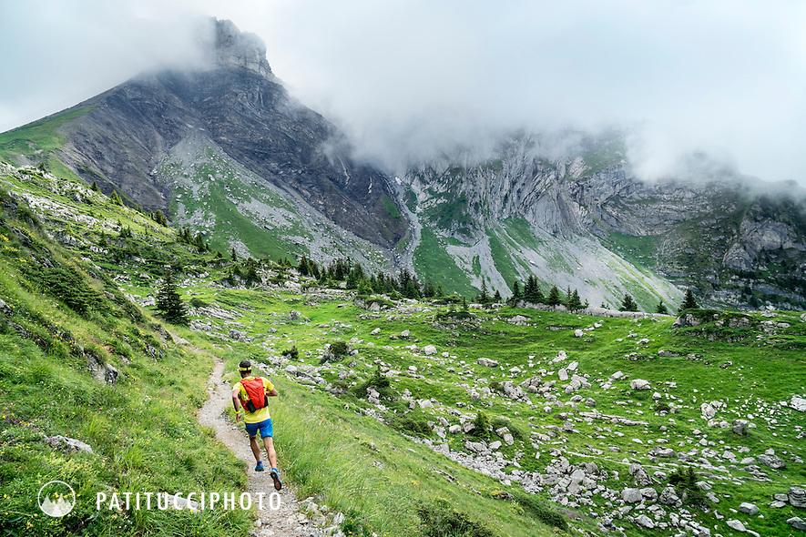 A trail runner on the Interlaken to Schynige Platte to Grindelwald Trail, Switzerland