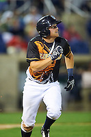 Wilmington Blue Rocks catcher Chad Johnson (7) runs to first base during a game against the Lynchburg Hillcats on June 3, 2016 at Judy Johnson Field at Daniel S. Frawley Stadium in Wilmington, Delaware.  Lynchburg defeated Wilmington 16-11 in ten innings.  (Mike Janes/Four Seam Images)