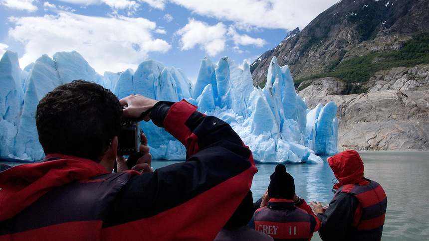 Tourists photograph the face of the Grey Glacier at Torres del Paine National Park in southern Chile. (Kevin Moloney for the New York Times)