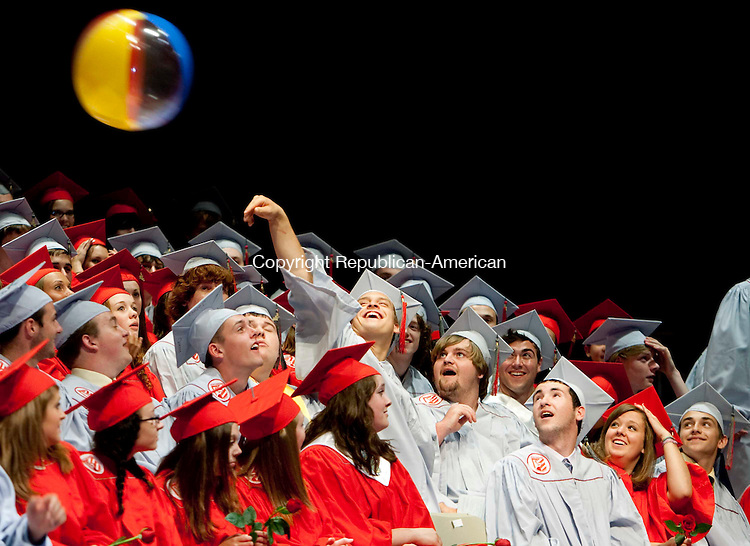 TORRINGTON, CT 23 JUNE, 2010-062310JS10-Northwestern Regional High School graduates play with a beach ball during graduation exercise Wednesday at the Warner Theatre in Torrington.<br /> Jim Shannon Republican-American
