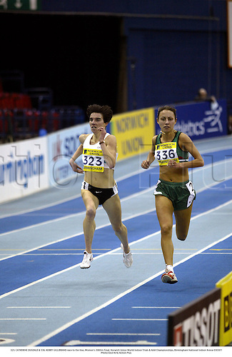 323. CATHERINE DUGDALE & 336. KERRY GILLIBRAND race to the line, Women's 3000m Final, Norwich Union World Indoor Trials & AAA Championships, Birmingham National Indoor Arena 030301 .Photo:Glyn Kirk/Action Plus...athletics 2003 distance woman women