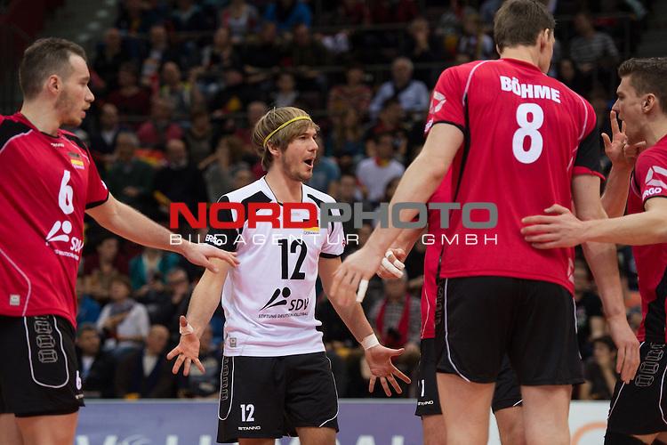 03.01.2014, MHP Arena, Ludwigsburg<br /> Volleyball, Qualifikation WM 2014, Deutschland vs. Kroatien<br /> <br /> Jubel Denis Kaliberda (#6 GER), Ferdinand Tille (#12 GER), Marcus B&ouml;hme / Boehme (#8 GER), Lukas Kampa (#11 GER)<br /> <br />   Foto &copy; nordphoto / Kurth