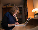 Tring, UK. 13.01.2014. Sam Potter, playwright and author, working on a manuscript at home. Sam writes at home, either in her bedroom or in her study. She recently received an Off West End Award nomination for Most Promising New Playwright for her debut play Mucky Kid which opened at Theatre503 in November 2013. In December 2013, Sam was appointed Creative Associate at Headlong theatre company and is currently working on a children's book and a play. Photograph © Jane Hobson.