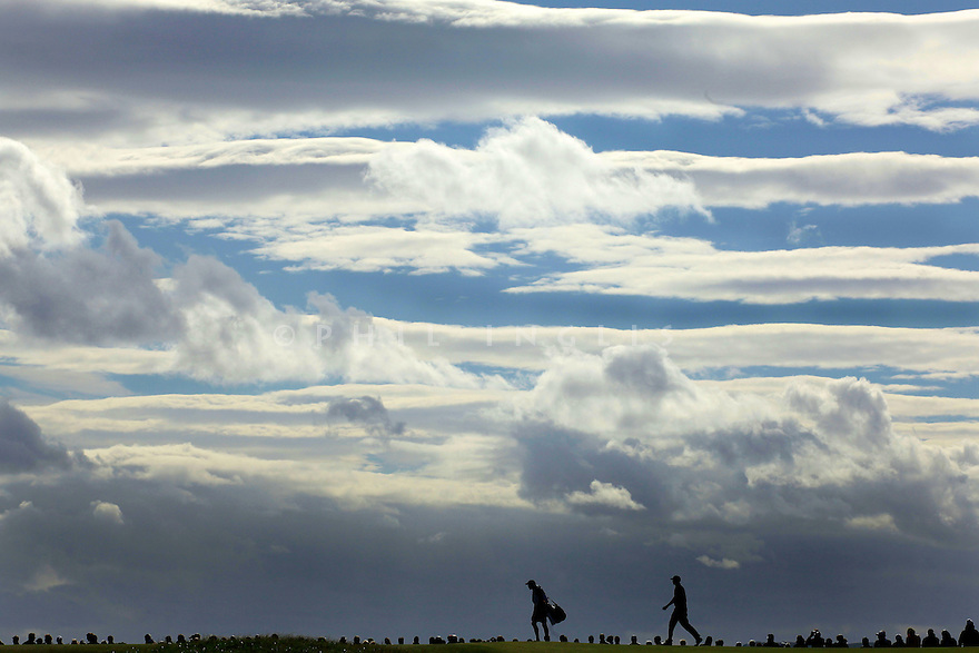 Tiger Woods (USA) and his caddie Steve Williams walk off the 12th tee during the third round of the 139th Open Championship played over the Old Course on 17th July 2010 at St Andrews, Fife,Scotland. Picture Credit / Phil Inglis