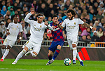 Real Madrid CF's Sergio Ramos FC Barcelona's forwar Lionel Messi and Real Madrid CF's Marcelo Vieira fights for the ball during La Liga match. Mar 01, 2020. (ALTERPHOTOS/Manu R.B.)
