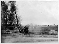 With the Canadians in the great battle<br /> Description<br /> <br /> A Canadian heavy howitzer in acton during the great battle. Note the charge leaving the muzzle