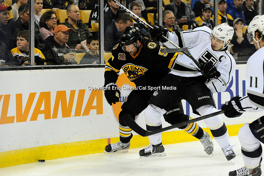 January 20, 2014 - Boston, Massachusetts, U.S. - Boston Bruins defenseman Johnny Boychuk (55) and Los Angeles Kings right wing Dustin Brown (23) battle for the puck during the NHL game between Los Angeles Kings and the Boston Bruins held at TD Garden in Boston Massachusetts. The Bruins defeated the Kings 3-2 in regulation time.   Eric Canha/CSM