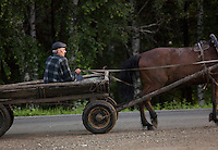 Man riding on horse and cart, Ekaterinburg, Russia.