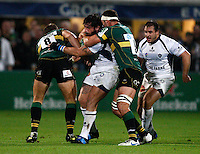 Photo: Richard Lane/Richard Lane Photography. Northampton Saints v Castres Olympique. Heineken Cup. 08/10/2010. Castres' Yannick Forestier is tackled by Saints' Roger Wilson (8) and Calum Clarke.