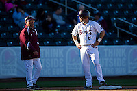 Spiker Helms (9) of the Missouri State Bears talks with Head Coach Keith Guttin (2) during a game against the Southern Illinois University- Edwardsville Cougars at Hammons Field on March 10, 2012 in Springfield, Missouri. (David Welker / Four Seam Images)