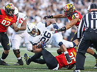 College Park, MD - November 25, 2017: Penn State Nittany Lions running back Saquon Barkley (26) gets tackled during game between Penn St and Maryland at  Capital One Field at Maryland Stadium in College Park, MD.  (Photo by Elliott Brown/Media Images International)