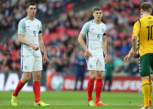 March 26th 2017, Wembley Stadium, London, England; World Cup 2018 Qualification football, England versus Lithuania; Michael Keane of England and John Stones of England look on