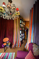 The long curtains in the study are made of a mixture of striped toile de Jouy and plain fabrics and also serve to conceal Bagnara's wardrobe