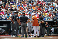 Head coach Mike Gillespie of the UC Irvine Anteaters and head coach Augie Garrido of the Texas Longhorns during Game 1 of the 2014 Men's College World Series between the UC Irvine Anteaters and Texas Longhorns at TD Ameritrade Park on June 14, 2014 in Omaha, Nebraska. (Brace Hemmelgarn/Four Seam Images)
