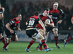 Robin Copeland of Munster Rugby is challenged by Fly half Dorian Jones of Newport Gwent Dragons.<br /> <br /> Guiness Pro 12<br /> Newport Gwent Dragons v Munster Rugby<br /> Rodney Parade<br /> 21.11.14<br /> &copy;Steve Pope-SPORTINGWALES