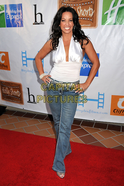 "CC PERKINSON .5th Annual Hollyshorts Film Festival Screening of ""Knuckle Draggers"" held at Laemmle's Sunset 5 Theatre, West Hollywood, CA , USA, .12th August 2009..full length hands on hips jeans white halterneck silver belt top denim .CAP/ADM/BP.©Byron Purvis/Admedia/Capital Pictures"