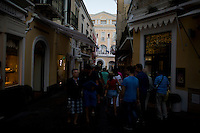 Tourists make their way through the streets on Monday, Sept. 21, 2015, on the island of Capri in Italy. (Photo by James Brosher)