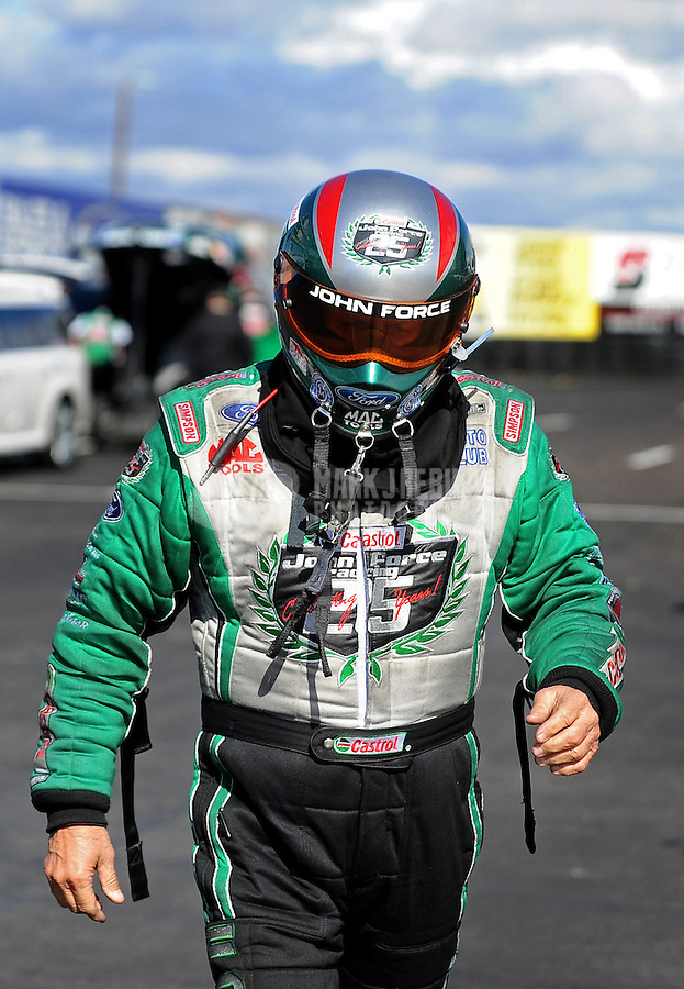 Feb. 22, 2010; Chandler, AZ, USA; NHRA funny car driver John Force during the Arizona Nationals at Firebird International Raceway. The race is being run Monday after weather and darkness led to the cancellation of Sunday race action. Mandatory Credit: Mark J. Rebilas-