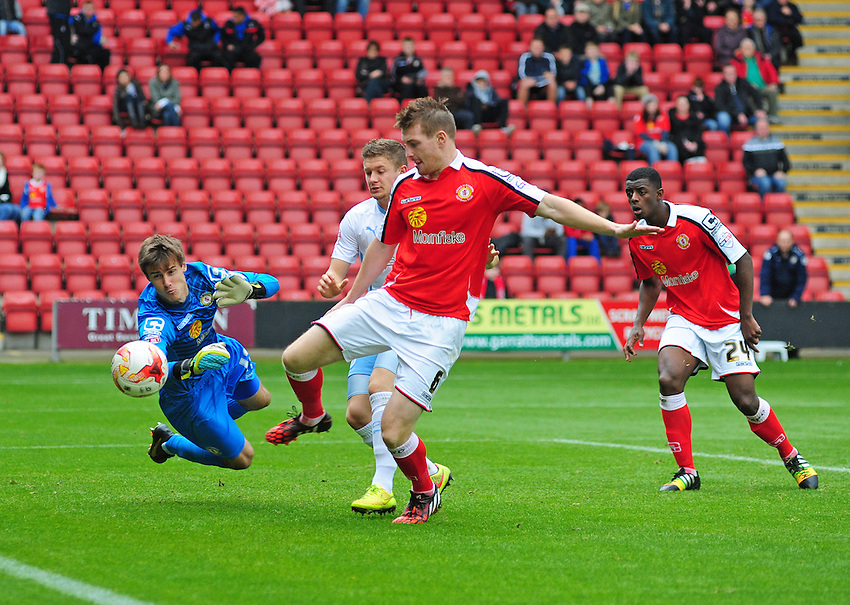 Crewe Alexandra's Ben Garratt makes a save at the feet of Coventry City's Aaron Phillips<br /> <br /> Photographer Chris Vaughan/CameraSport<br /> <br /> Football - The Football League Sky Bet League One - Crewe Alexandra v Coventry City - Saturday 11th October 2014 - Alexandra Stadium - Crewe<br /> <br /> &copy; CameraSport - 43 Linden Ave. Countesthorpe. Leicester. England. LE8 5PG - Tel: +44 (0) 116 277 4147 - admin@camerasport.com - www.camerasport.com