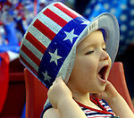 Cameron Szemreylo, 1, of Tolland, shows isl American spirit at the start of the kids parade during the annual July in the Sky celebration, Wednesday, July 3, 2013, in down Rockville.  (Jim Michaud / Journal Inquirer)