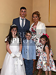 Moya Farrelly from St Brigids school who recieved first holy communion in Our Lady of Lourdes church with parents Michael and Sandra, brother Tadhg and sister Tori. Photo:Colin Bell/pressphotos.ie
