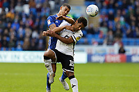 (L-R) Lee Peltier of Cardiff City challenges Wayne Routledge of Swansea City during the Sky Bet Championship match between Cardiff City and Swansea City at the Cardiff City Stadium, Cardiff, Wales, UK. Sunday 12 January 2020
