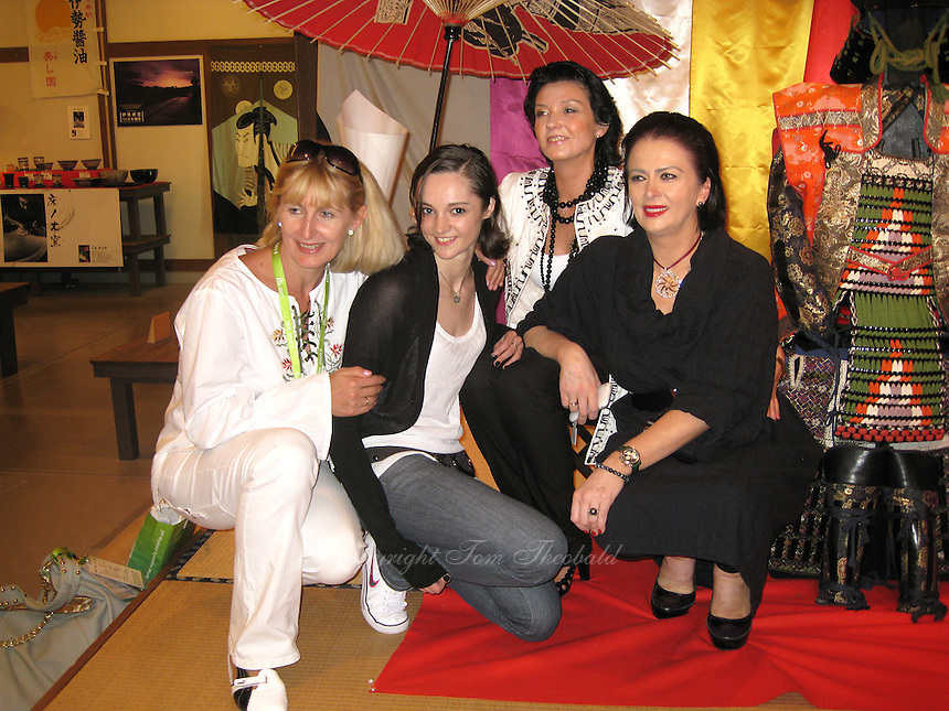 September 13, 2009; Mie, Japan;  Ukrainian delegation members (L-R) Nataliya Yeromina (judge), Anna Bessonova, Viktoria Bessonova, Irina Deriugina pose for portrait at banquet after 2009 World Championships Mie. Photo by Tom Theobald. .
